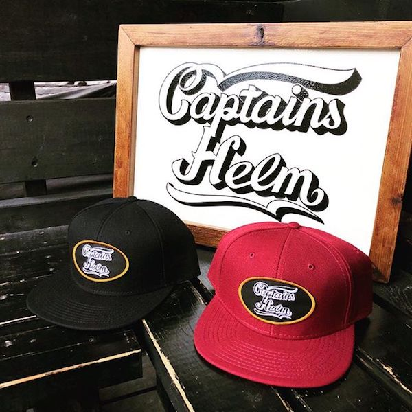 CAPTAINS HELM WING LOGO SNAP BACK