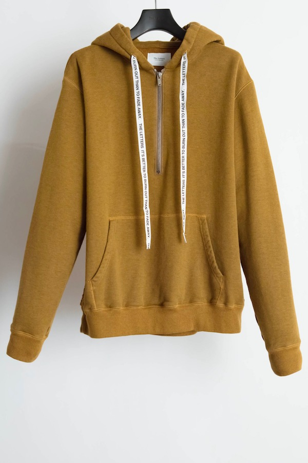 The Letters Side Reversed Hooded Half Zip Sweat.